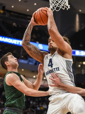 Marquette forward Theo John pulls down a rebound in the exhibition game against St. Norbert.