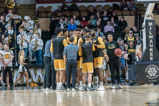 Guard Te'Jon Lucas, right, was on the outside looking in as he waited a year to become eligible to play for UW-Milwaukee after transferring from Illinois.