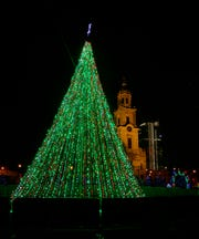 Cathedral Square Park holiday decorations include a large Christmas tree lit up near the Cathedral of St. John the Evangelist church in Milwaukee, Wisconsin, on Sunday December 17, 2017.