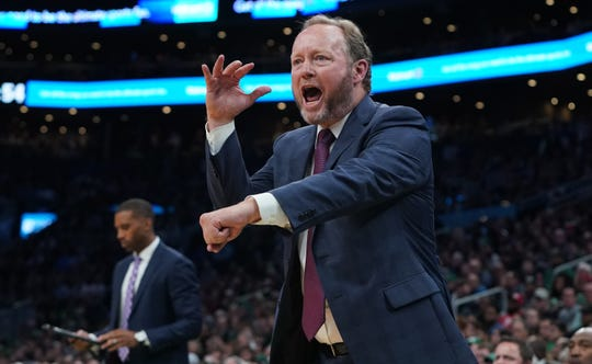 Bucks head coach Mike Budenholzer argues with the refs as he looks for a call during the fourth quarter against the Celtics.