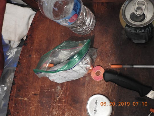 Milwaukee Police and FBI seized cocaine, heroin, drug paraphernalia and evidence of prostitution during a June raid at the 37th Street house.