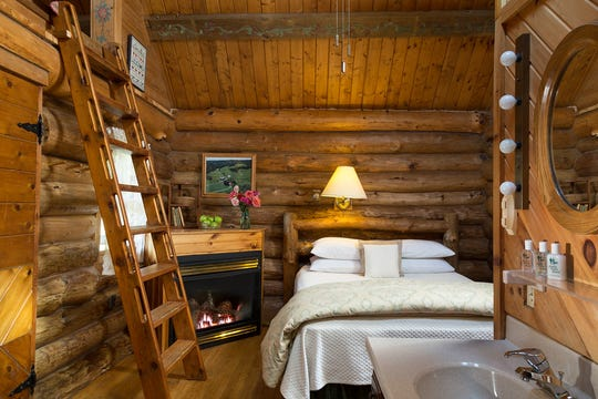 The Little House on the Prairie cabin at Justin Trails Resort in Sparta has a queen-size bed and fireplace on its main level, with a ladder leading to a loft with a whirlpool tub.
