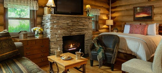 The Paul Bunyan log cabin at Justin Trails Resort in Sparta has a queen bed, sitting area and gas fireplace on its main level.