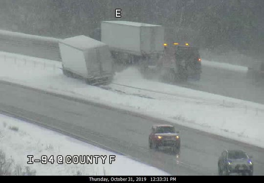 This freeway camera image shows a semi that skidded off I-94 in Jefferson County on Thursday. Moderate to heavy snow was making some roads and highways slippery.