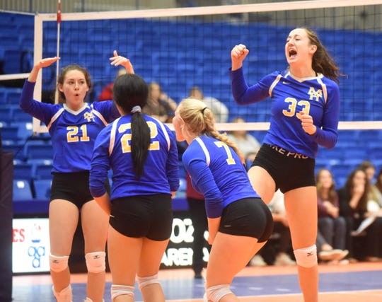 Mountain Home Lady Bombers Charlie Pierce (from left), Kiana Chapa, Leah Jackson and Anna Grace Foreman celebrate a point against Benton on Wednesday.