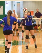 Cotter's Mai Tathong sets during the Lady Warriors' match against St. Joseph on Wednesday.