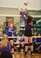 Cotter's Tylar Coots hits over St. Joseph's Abbie Flake on Wednesday.