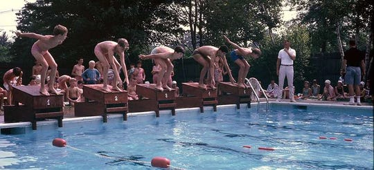 Kids participate at a swim match at the neighborhood pool in 1968.