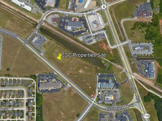 This image provided by real estate developer CSC Properties shows the site of the planned EastChase Corner development.