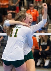 Edgewood's Alex Hodge and Katie Roberts celebrate their championship win during the AISA State Volleyball Tournament at the Cramton Bowl Multiplex in Montgomery, Ala., on Thursday October 31, 2019.