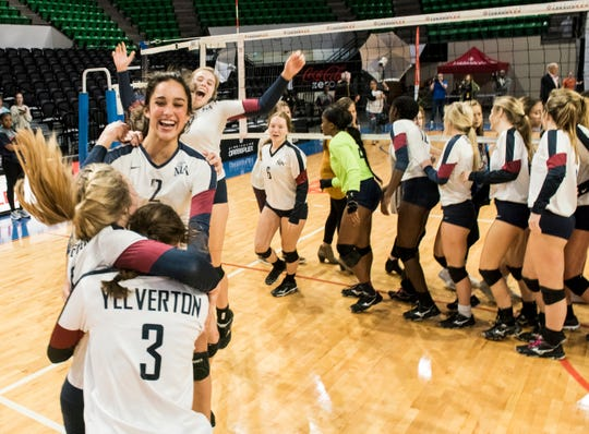 Montgomery Academy players celebrate their state championship victory at the Birmingham Crossplex in Birmingham, Ala., on Thursday, Oct. 31, 2019. Montgomery Academy defeated Geraldine in three sets.