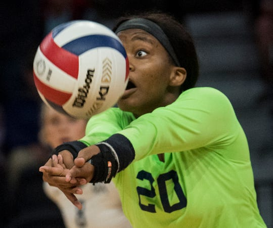 Montgomery Academy's Grace Jackson (20) digs the ball at the Birmingham Crossplex in Birmingham, Ala., on Thursday, Oct. 31, 2019. Montgomery Academy defeated Geraldine in three sets.