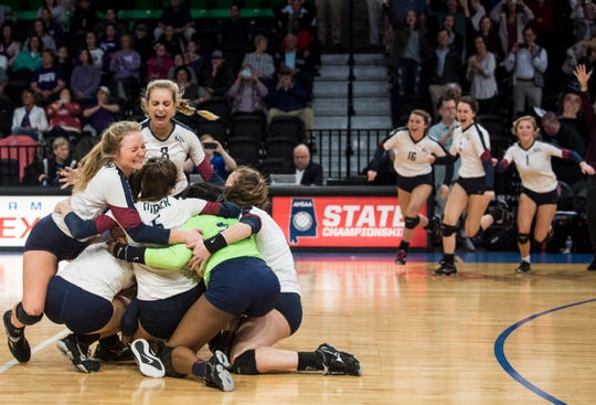 Montgomery Academy's team celebrates the state championship victory at the Birmingham Crossplex in Birmingham, Ala., on Thursday, Oct. 31, 2019. Montgomery Academy defeated Geraldine in three sets.