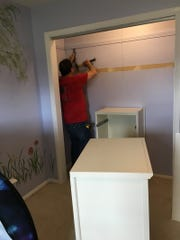 Martin Brown, a Dream Nest volunteer, helped install the new closet system in Clara's room.