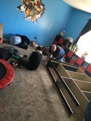 Dream Nest volunteers building Liam's new furniture.