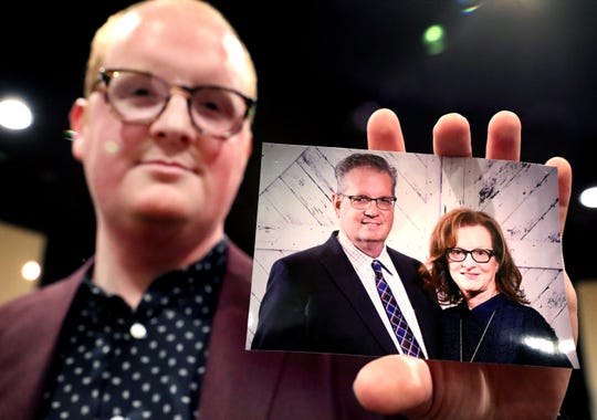 Kevin Nerren holds a photo of his parents, Bryan and Rhonda Nerren, on Oct. 30, 2019. Bryan Nerren was arrested in India and later cleared of wrongdoing but hasn't been able to leave the country.