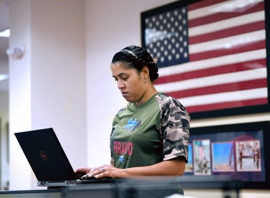 Marine veteran and MTSU student Teresa Carter works on her computer at the Charlie and Hazel Daniels Veterans and Military Family Center at MTSU on Thursday, Oct. 31, 2019.