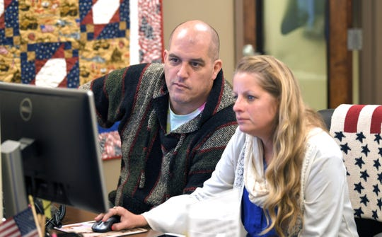 Army veteran and MTSU student Chuck Bolding gets help from office manager Elizabeth Wilburn, a veteran herself, at the Charlie and Hazel Daniels Veterans and Military Family Center at MTSU on Thursday, Oct. 31, 2019.