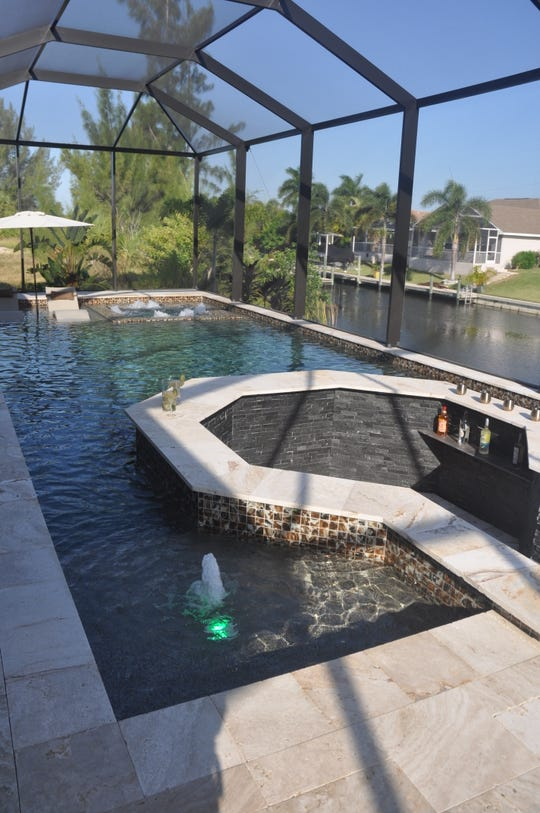 One of the most distinctive features of this home is the sunken, swim-up bar in the swimming pool.