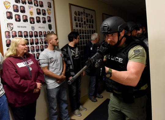 Newark Police Officer Adam Carter and members of the division's Special Operations Group demonstrate an area sweep and other tactics during the Citizens' Police Academy on Wednesday, Oct. 30, 2019. Newark police's SOG turned 30 this year in January.