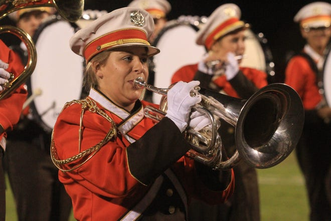 Senior field commander Lindsey Drumm performs with the Heath HS marching band.