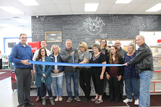"""Papa Joe's Hometown Kitchen"" officially opened within Buster's Corner Store on Oct. 28 with a ribbon cutting, including chamber members and Pataskala Mayor Mike Compton."