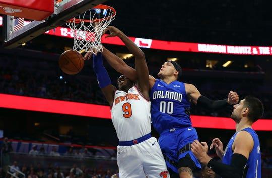Oct 30, 2019; Orlando, FL, USA; Orlando Magic forward Aaron Gordon (00) fouls New York Knicks forward RJ Barrett (9) during the first quarter at Amway Center. Mandatory Credit: Kim Klement-USA TODAY Sports