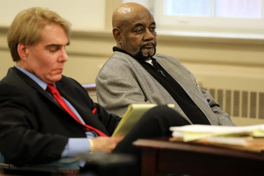 Hudy Muldrow (background) and his attorney, Matthew Reisig,  are shown at the defense table in Judge Stephen Taylor's courtroom at the Morris County Courthouse. Reisig argued, unsuccessfully that the case should be moved out of northern New Jersey to acquire an unbiased jury for the case, which is scheduled to start in late January. Thursday, October 31, 2019