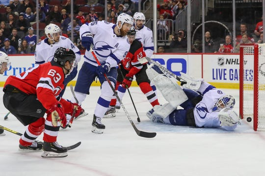 New Jersey Devils' Jesper Bratt (63) watches as his shot beats Tampa Bay Lightning goalie Curtis McElhinney on Wednesday, Oct. 30, 2019 during a game at Prudential Center in Newark.