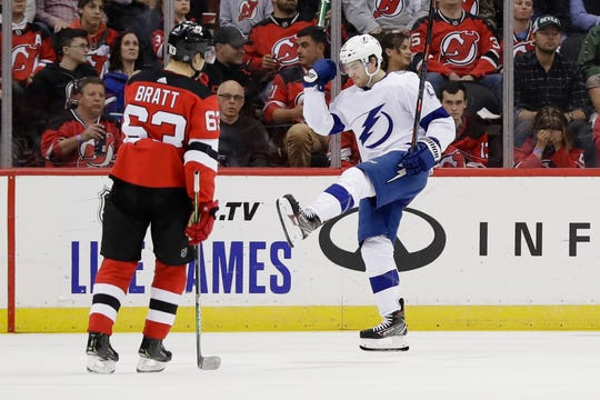 Tampa Bay Lightning's Brayden Point, right, celebrates after scoring a goal as New Jersey Devils' Jesper Bratt (63) skates nearby during the second period of an NHL hockey game Wednesday, Oct. 30, 2019, in Newark, N.J.