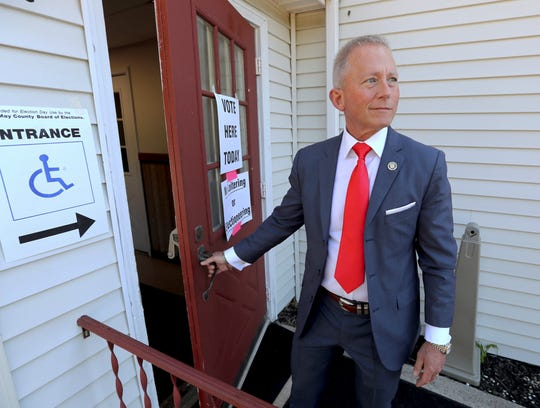 FILE- In this June 5, 2018 file photo, New Jersey State Senator Jeff Van Drew, D-1st, arrives at the Ocean View Fire Hall in Dennis Township, N.J., to cast his vote in the mid-term primary election. Van Drew is running for the House of Representatives in New Jersey's second Congressional District. (Dale Gerhard/The Press of Atlantic City via AP, File)