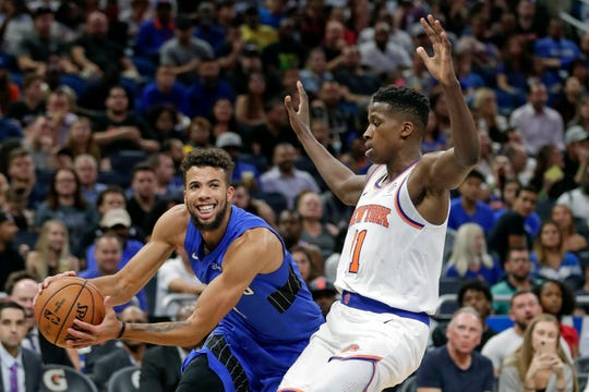 Orlando Magic's Michael Carter-Williams, left, tries to get around New York Knicks' Frank Ntilikina during the second half of an NBA basketball game, Wednesday, Oct. 30, 2019, in Orlando, Fla. (AP Photo/John Raoux)