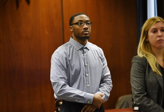 Khalil Wheeler-Weaver, who is charged in the death of Sarah Butler, 20, of Montclair, stands as the jury enters the courtoom. He is being tried for the serial murders of three women in 2016. October 31, 2019.