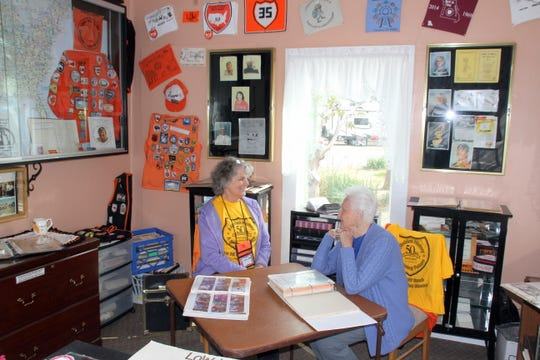 Laurie Neff, left, and June Davidson share memories of Neff's mother, Edith Lane, founder of the Loners on Wheels RV Club, in the Memory Room of the LoW-Hi RV Ranch south of Deming, NM.