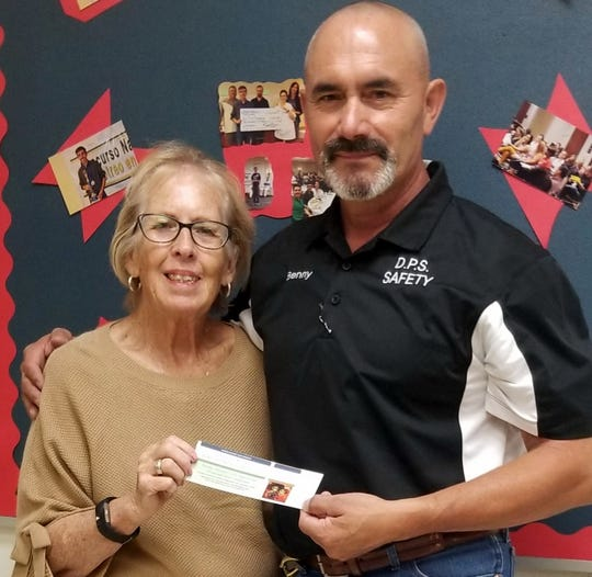 Deming Mayor Benny Jasso purchased a ticket from Deming Rotary Club member Mary Lou Cameron for the Dia de los Muertos Auction and Wine event to be held from 5:30 to 8:30 p.m. Nov. 7, at the D.H. Lescombes Winery in Deming, NM. Donation is $25 per person and that includes two tickets for win and food. The event will feature a silent auction, door prizes, wine specials. live music and catering by Adobe Deli. The winery is located at 1325 De Baca Road SE. All proceeds to go Rotary's community support projects.