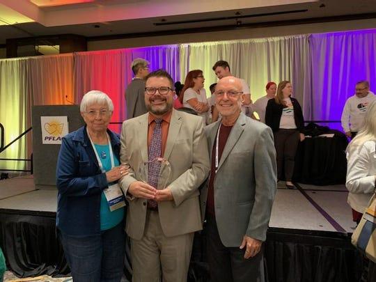 PFLAG Las Cruces Board Members Liz Ambrose, Ryan Steinmetz, and Michael Breard.