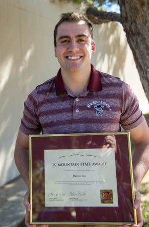 Marcus Gay, a student program coordinator for the New Mexico Water Resource Research Institute at New Mexico State University, the 'A' Mountain Staff Award.
