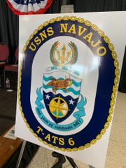 "The crest for the future USNS Navajo (T-ATS 6) was displayed at the keel laying ceremony on Oct. 30 in Houma, Louisiana. The motto is written in the Navajo language and translates to ""the vessel of the protectors of life."""