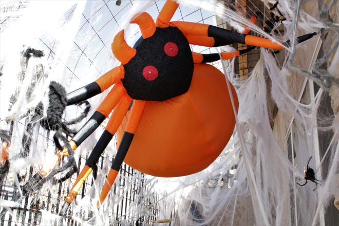 A giant plastic spider looms over trick-or-treaters at the Cunningham Haunt House in Farmington on Oct. 31, 2019.