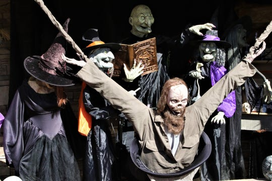 A group of witches and warlocks greet trick-or-treaters at the Cunningham Haunt House in Farmington on Oct. 31, 2019.