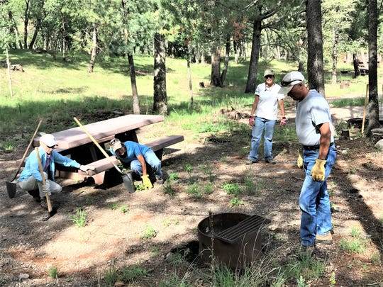 Cleaning up picnic areas also was on the list of chores volunteers tackled.