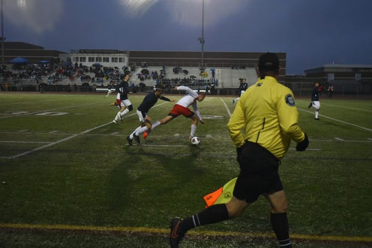 Salem's Oct. 30 game was played in the wind and rain and cold at Troy Athens High.
