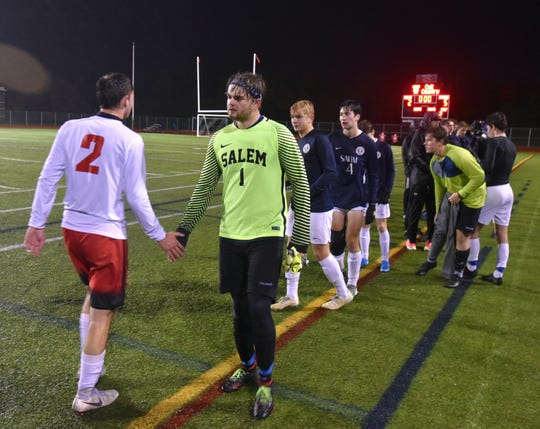 The Salem High Rocks congratulate the Troy Athens High soccer team after losing to them in the state semi finals on Oct. 30.