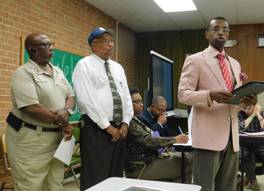 Opelousas City Marshal Paul Mouton (center) and Pastor Floyd Prescott III submit proposals earlier this week for the use of the former North Elementary School building. At left is Gerald Greene, coordinator for parish programs for St. Landry's elderly.