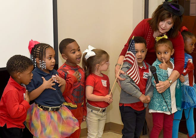 St. Landry Parish Head Start Director June Inhern directs students in the recital of the Pledge of Allegiance during a community appreciation luncheon in 2019. The Louisiana Department of Education has awarded excellent ratings for 11 schools and early childhood centers whose educational progress the district oversees.