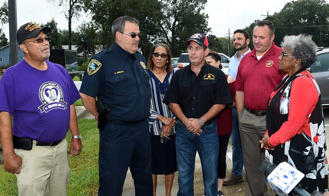 Patricia Mason-Guillory, project chairman for the St. Landry Parish Veterans Memorial, speaks to former parish military veterans and Port Barre Police Officer Ken Breaux, who is responsible for privately funding a security system at the site off La. 182 south of Opelousas. Included in the event are Michael Rideau , a Viet Nam War veteran, Breaux, Todd Abhire, a member of the Veterans Memorial Board, Glenn Hollier, who wired the security system, Ty Lanclos of Electronic Protection Systems and military veteran Jean-Pierre Cartou.