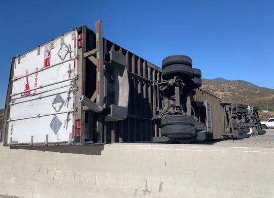 One of several overturned trucks on the Interstate 15 freeway on Wednesday, Oct. 30, 2019, caused major traffic headaches. This rig spanned both directions. Trucks were blown over by strong winds, similar to those expected on Thursday, Oct. 31, 2019.