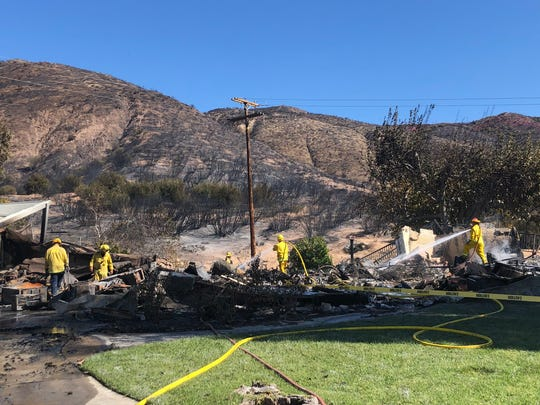 Firefighters put out hot spots caused by the Hillside Fire near San Bernardino in October 2019. Fire and weather officials say the 2020 wildfire season may begin early due to a lack of rain in January and February.