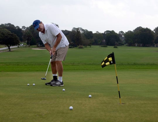 Pensacola Beach resident Joe Spencer works on his short game at the Tiger Point Golf Club in Gulf Breeze on Oct. 31. The golf course's back nine holes have been sold to the school district and a private developer.
