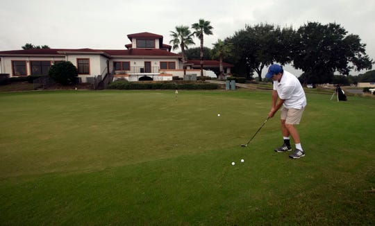 Pensacola Beach resident Joe Spencer works on his short game at the Tiger Point Golf Club in Gulf Breeze on Thursday.